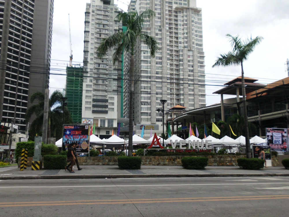 View of  Venue Mall at along Makati Avenue from across the street during the day.