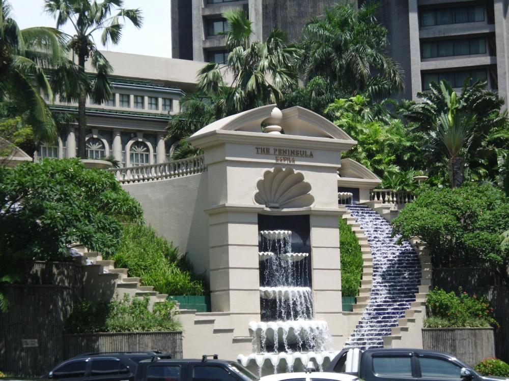 The stunning facade of The Peninsula Hotel at Makati Avenue